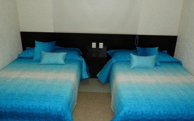 Отель Condominio Banus Diamante La Isla Acapulco комната для гостей