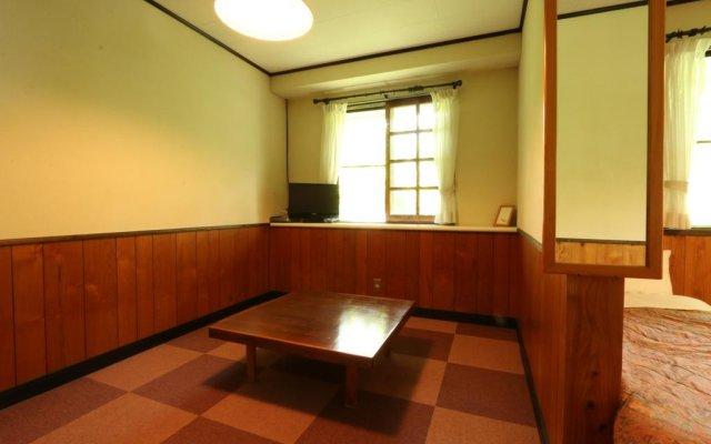 Отель Flower Garden Япония, Минамиогуни - отзывы, цены и фото номеров - забронировать отель Flower Garden онлайн комната для гостей