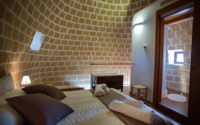 Отель Grandi Trulli Bed & Breakfast Альберобелло комната для гостей