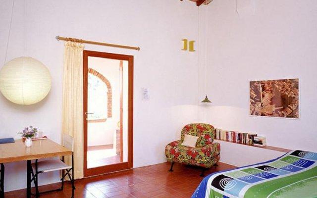 Отель Podere Mencoini Синалунга комната для гостей