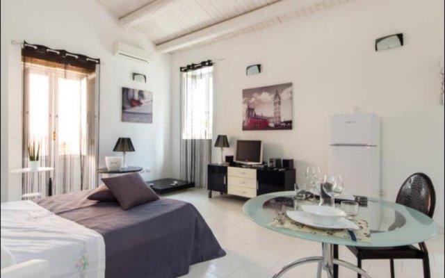 Отель Monolocale Via Arizzi Сиракуза комната для гостей