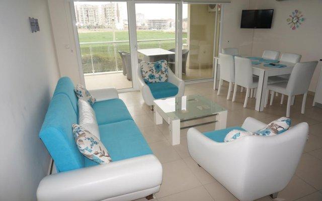 Апартаменты Apartments Orion City комната для гостей