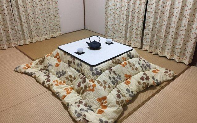 Отель Tokyo Kamakura House комната для гостей