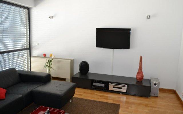 Апартаменты Expo Apartment комната для гостей