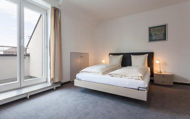 Апартаменты EMA House Serviced Apartments, Seefeld комната для гостей