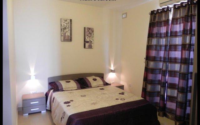 Апартаменты Marsascala Luxury Apartment & Penthouse Марсаскала комната для гостей