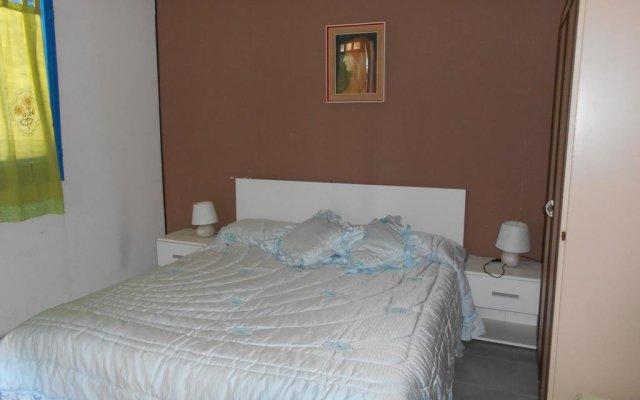 Отель Holiday home Riserva Marina Protetta Италия, Сиракуза - отзывы, цены и фото номеров - забронировать отель Holiday home Riserva Marina Protetta онлайн комната для гостей