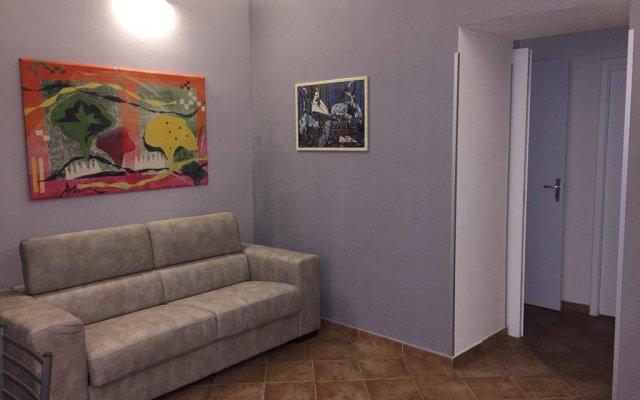 Отель Calarossa residence Сиракуза комната для гостей