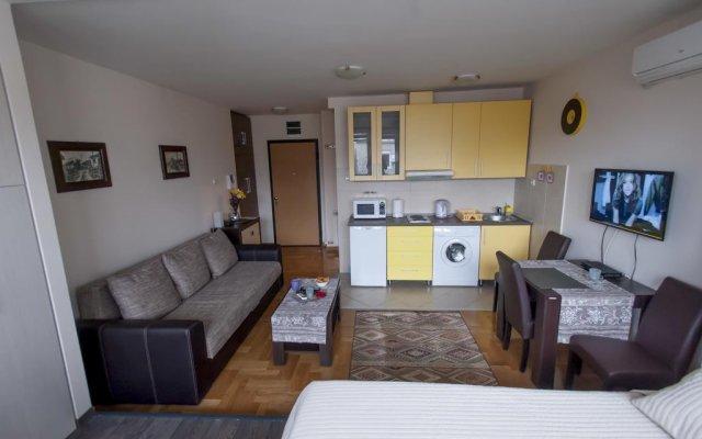 Апартаменты Mige Apartment комната для гостей