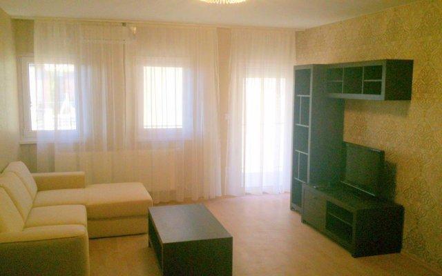 Апартаменты 1000 Home Apartments комната для гостей