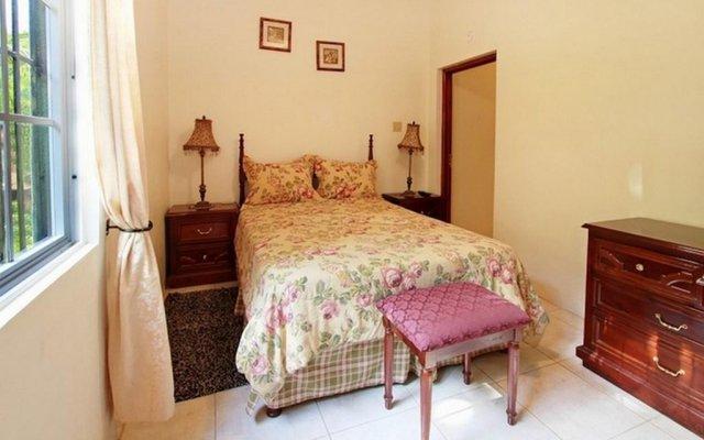 Отель Valencia Villa Ямайка, Очо-Риос - отзывы, цены и фото номеров - забронировать отель Valencia Villa онлайн комната для гостей