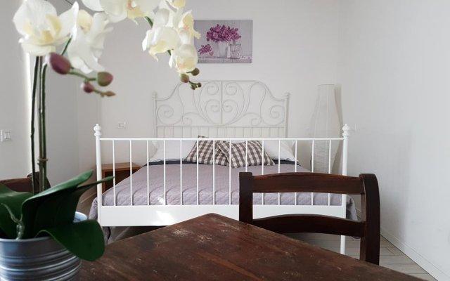 Отель Dolci Notti di Maga Cacao Чивитанова-Марке комната для гостей