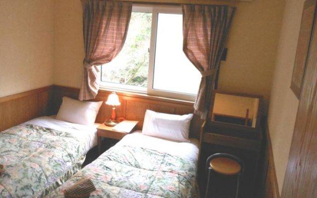 Отель Pension Flying Jeep Япония, Минамиогуни - отзывы, цены и фото номеров - забронировать отель Pension Flying Jeep онлайн комната для гостей