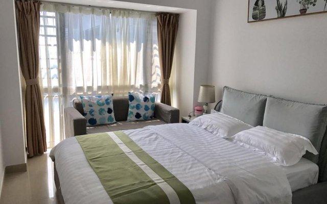 Апартаменты Shenzhen Wozhan Apartment K K Mall комната для гостей