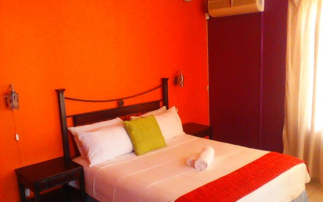 Отель Mmalai Guest House Габороне комната для гостей