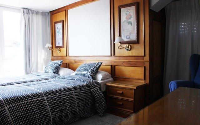Отель Apartamentos El Jornu комната для гостей
