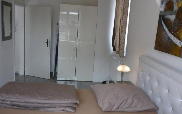 Отель NAAM Apartment Frankfurt City-Messe Airport Германия, Франкфурт-на-Майне - отзывы, цены и фото номеров - забронировать отель NAAM Apartment Frankfurt City-Messe Airport онлайн комната для гостей