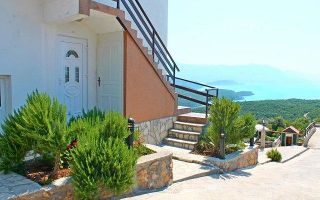 Апартаменты Apartments Villa Milna 1 вид на фасад