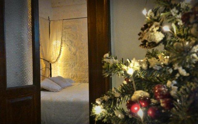 Отель Trulli Mille e una Notte Альберобелло комната для гостей