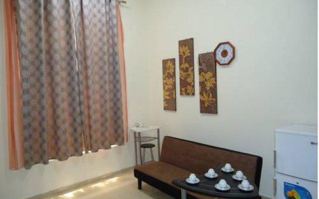 Al Hilli Hotel Apartments комната для гостей