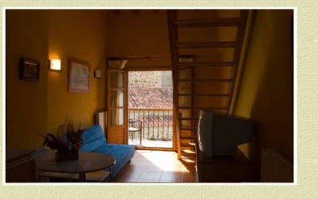 Отель Apartamentos Brisas del Deva Потес комната для гостей