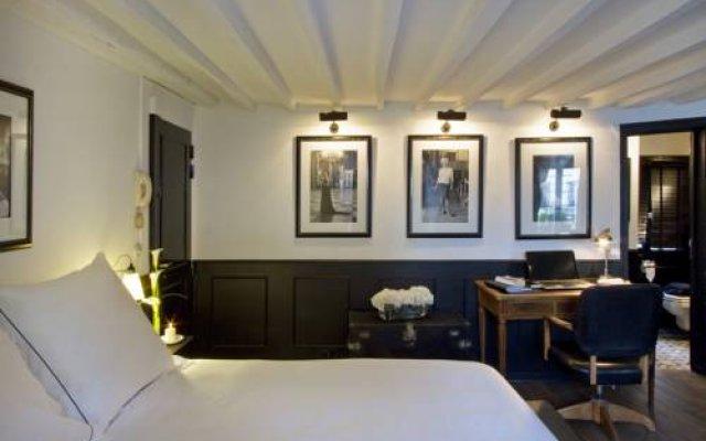 Отель Les Suites Parisiennes Франция, Париж - отзывы, цены и фото номеров - забронировать отель Les Suites Parisiennes онлайн интерьер отеля