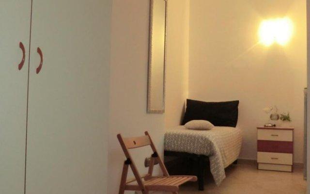 Отель Holidays House Sannì Аджерола комната для гостей