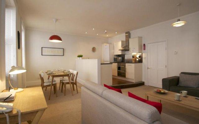 Апартаменты Acorn Gower Street Apartments Лондон комната для гостей