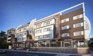 Отель Ducassi Suites Beach Club & Spa Rooftop Pool