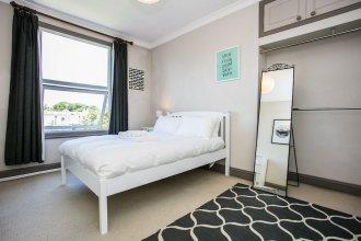 Spacious 4 Bedroom Home In Finsbury Park