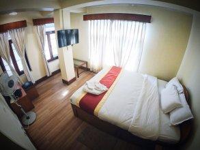 Bodhi Inn & Suite