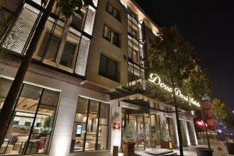 Отель Dosso Dossi Downtown