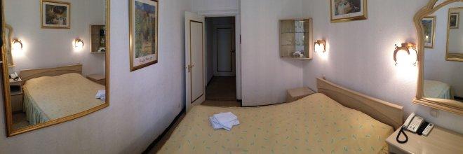 Отель Ист-Вест