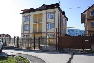 Olimpiysky Guest House